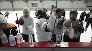Photo Gallery: L.A. Kings alumnus Daryl Evans runs hockey clinic for women