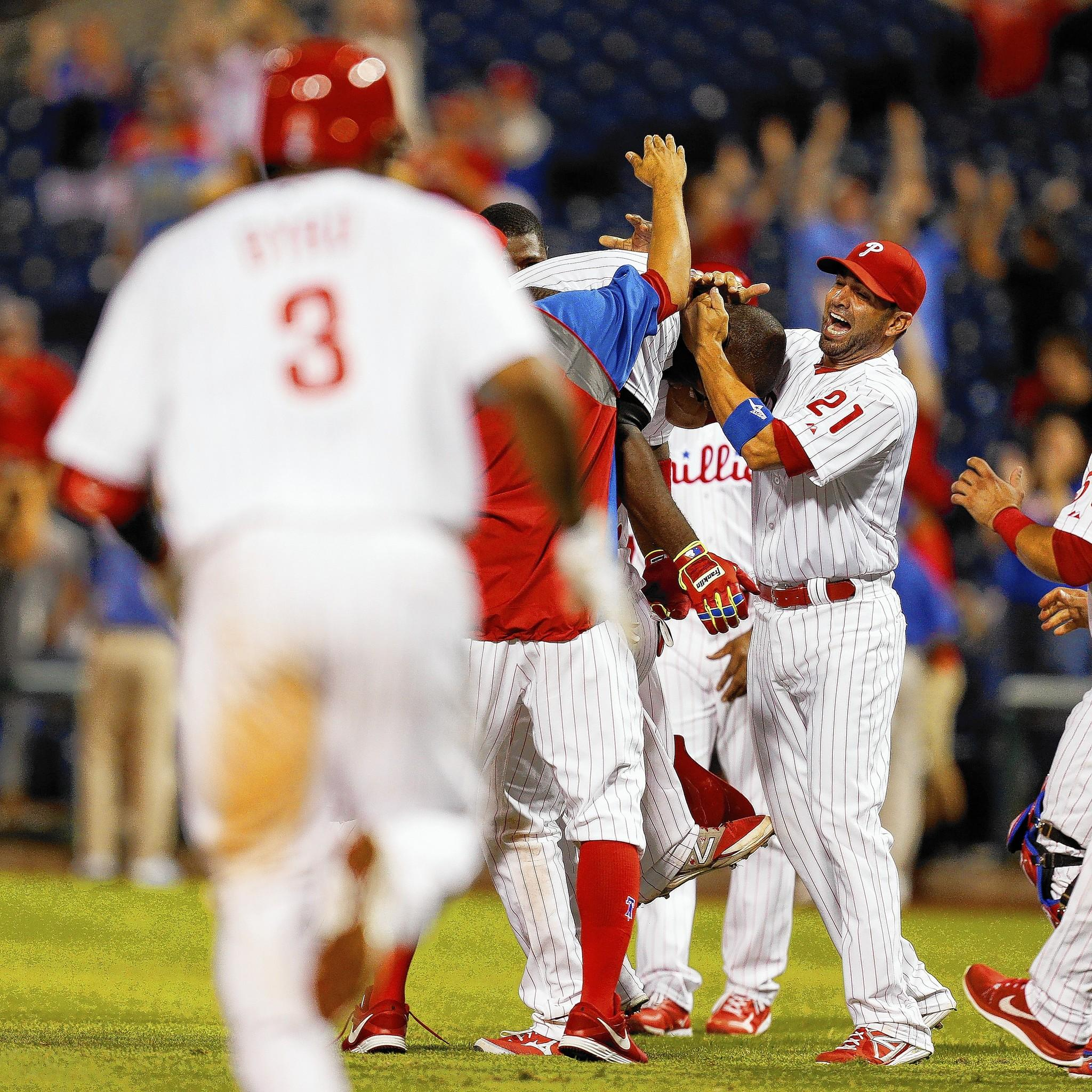 Ryan Howard of the Philadelphia Phillies is swarmed by teammates including Wil Nieves (right) after Howard hit a walk off RBI single in the bottom of the 15th inning of the game against the Houston Astros at Citizens Bank Park.