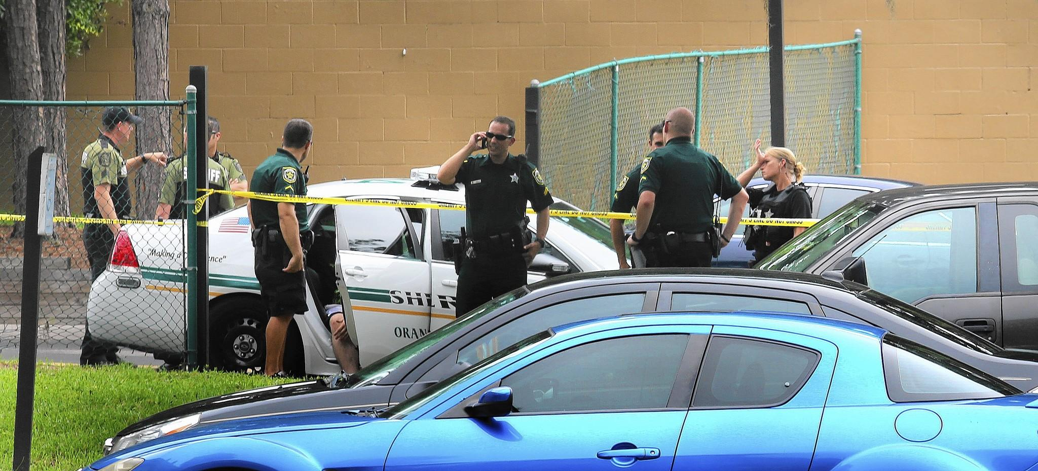 Orange County sheriffs on the scene of the double homicide in Pine Hills, Tuesday, August 5, 2014.