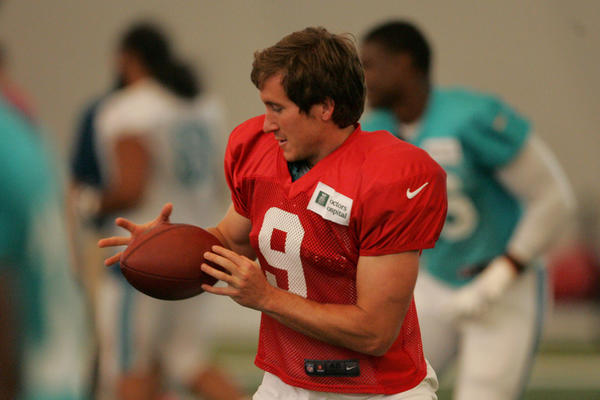 Kicker Caleb Sturgis (9) catch a ball during a drill at Dolphins training camp.