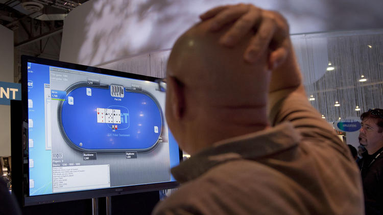 An online poker demonstration at a gambling industry conference in Las Vegas. (Julie Jacobson / Associated Press)