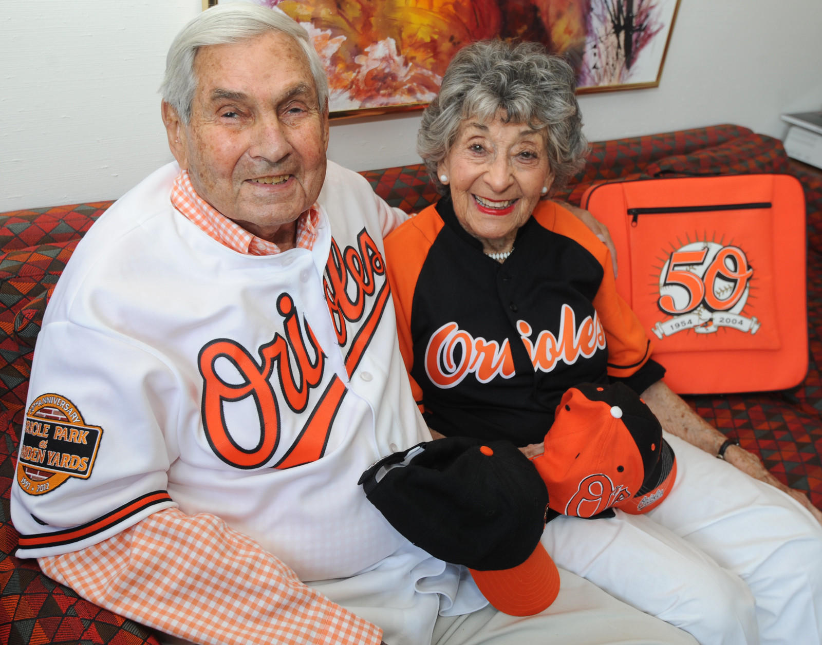 Nathan Goldberg, 95, is a 60-year Orioles season-ticket holder who will be among a group of long-time customers celebrated by the team Friday night. He's pictured with his wife, Lucille in their home.