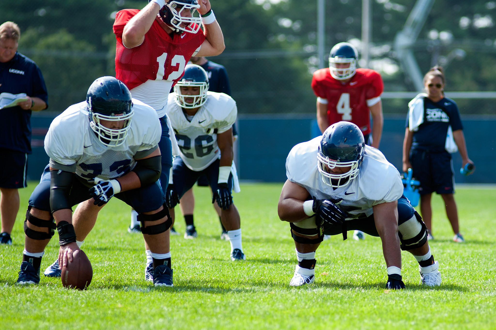 Offensive Linemen, Alex Mateas, left, and Guz Cruz run through formations during practice Wednesday.