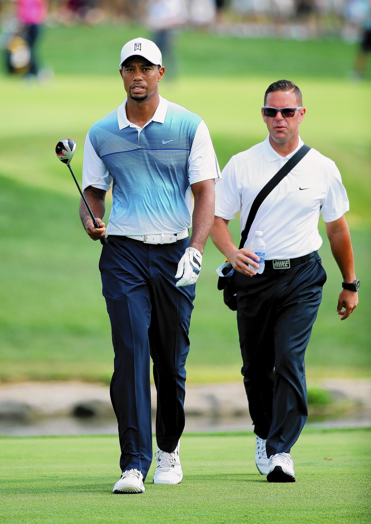 Tiger Woods, left, of the United States walks with golf instructor Sean Foley during a practice round prior to the start of the 96th PGA Championship at Valhalla Golf Club on August 6, 2014 in Louisville, Kentucky.