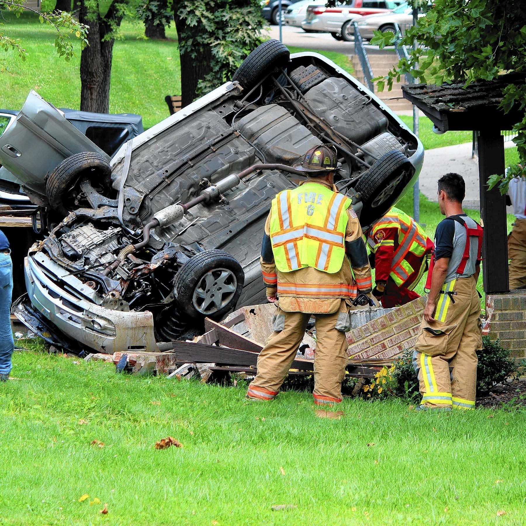 State police and local firefighters in North Whitehall Township investigate the Wednesday morning car crash that seriously injured Douglas and Jacqueline Lloyd of Coplay in front of the Sand Spring Apartments complex.