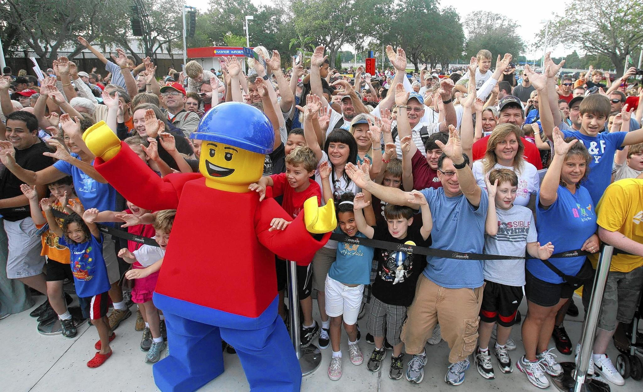 "Guests cheer with mascot ""Buddy"" at the entrance to Legoland Florida in this file photo."