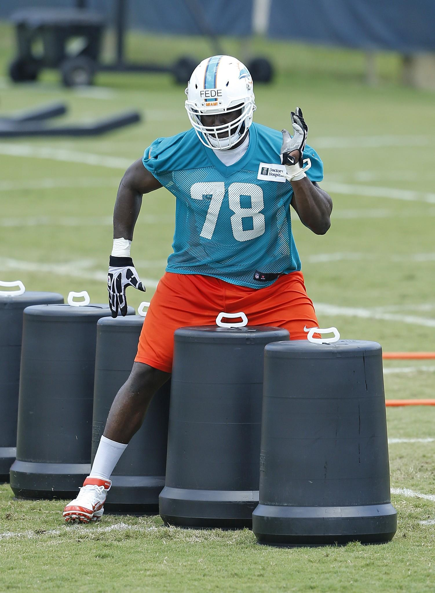Terrence Fede #78 of the Miami Dolphins participates in drills during the rookie minicamp on May 23, 2014 at the Miami Dolphins training facility in Davie, Florida.