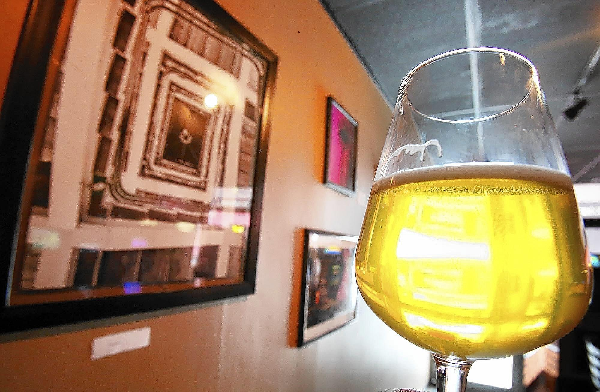 Art is on display at the BART bar in Orlando on Saturday, August 2, 2014.