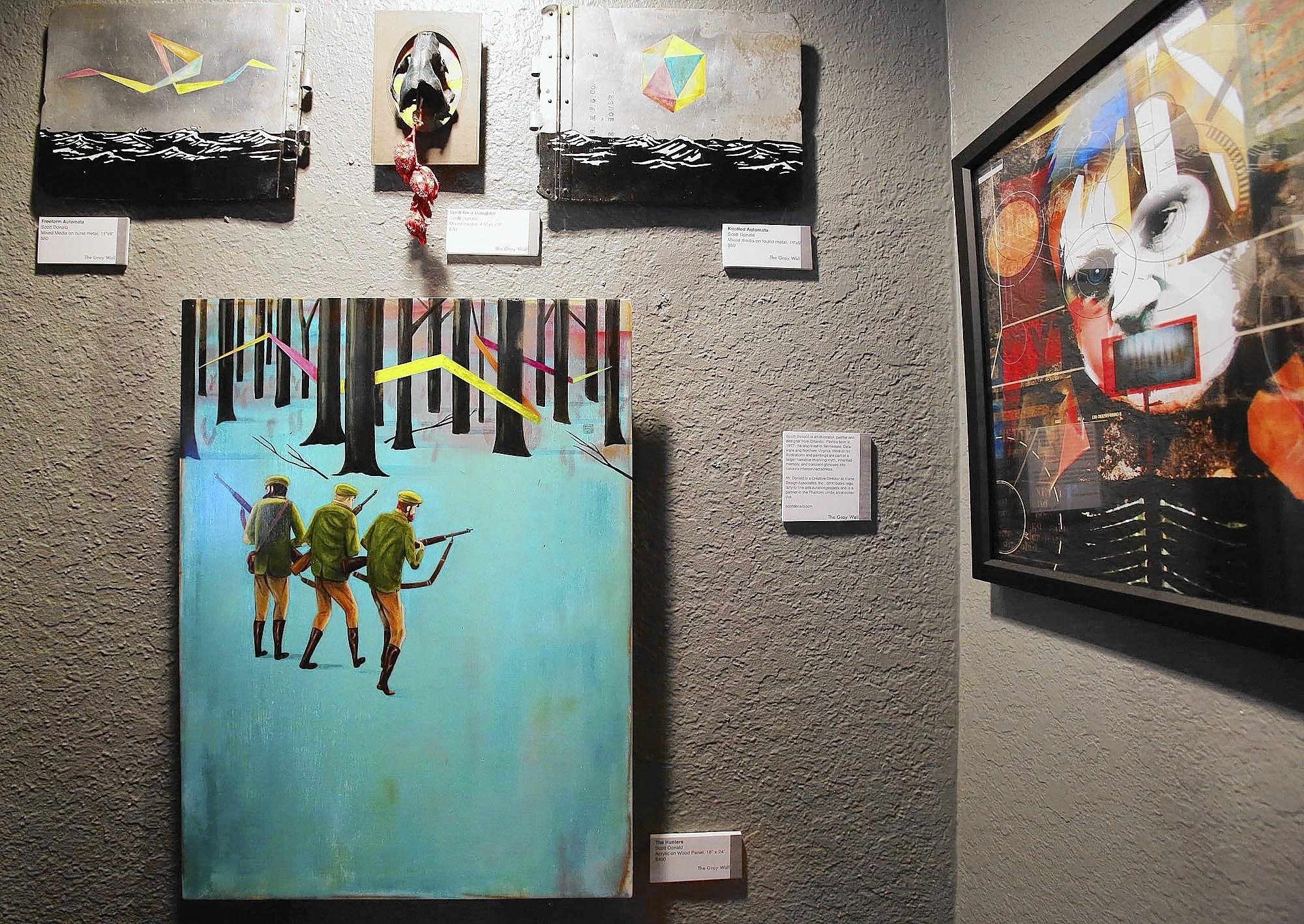 Art is on display at the Falcon Bar & Gallery in Orlando on Saturday, August 2, 2014.