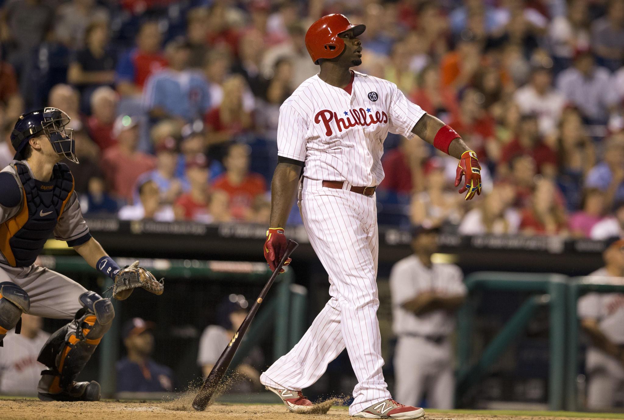 PHILADELPHIA, PA - AUGUST 7: Ryan Howard #6 of the Philadelphia Phillies hits a grand slam in the bottom of the eighth inning against the Houston Astros on August 7, 2014 at Citizens Bank Park in Philadelphia, Pennsylvania.