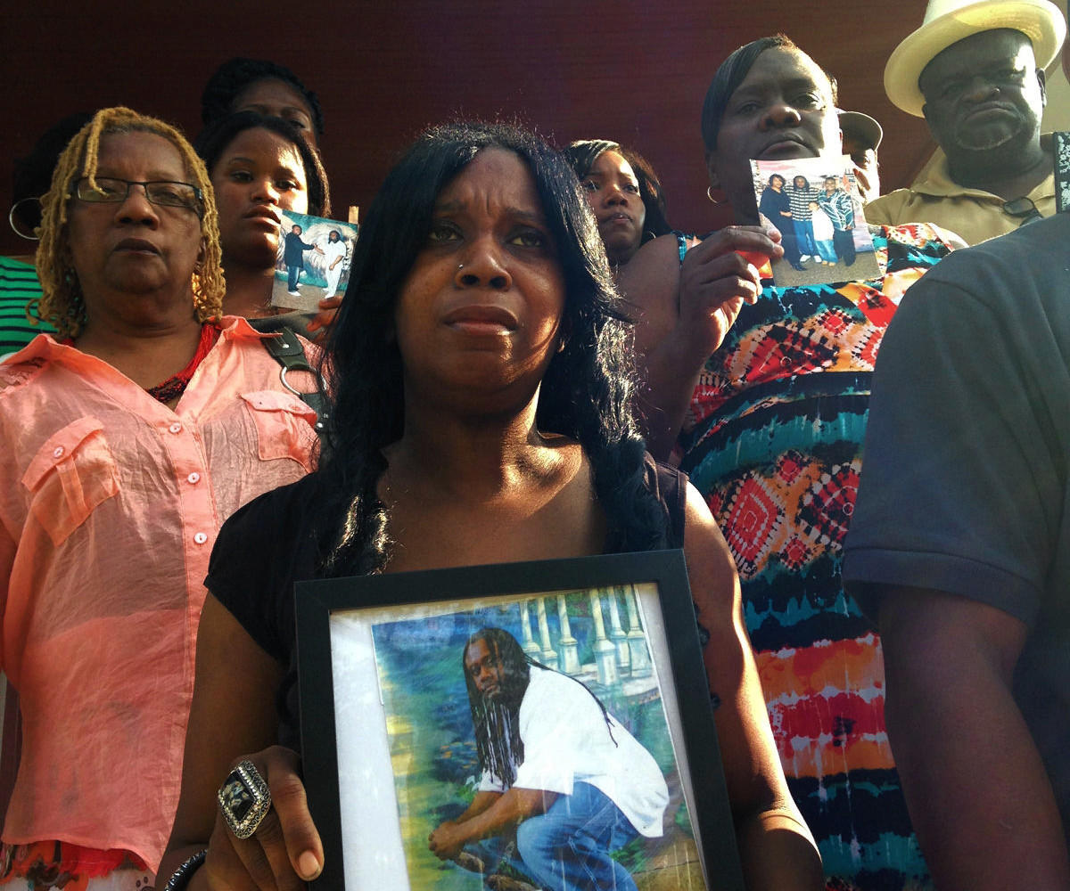 Joined family and supporters, Tawanda Jones (center), sister of the late Tyrone West, believes the Baltimore Police Department was responsible her brother's in-custody death.