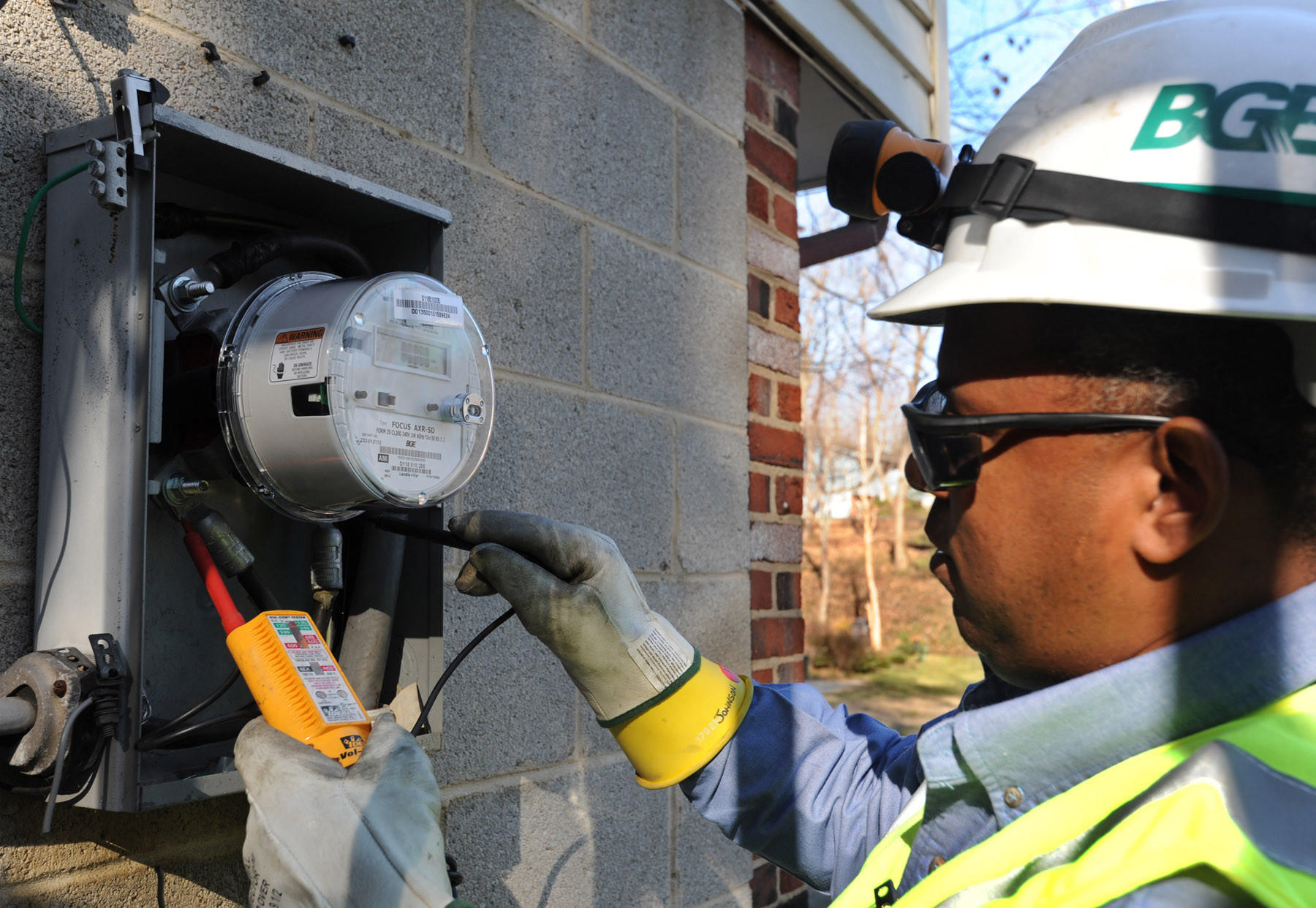 Rudolph Johnson III, a BGE meter crew leader, tests the voltage of a new AMI (Advanced Meter Infrastructure) smart meter he just installed on a home on Hoot Owl Rd.