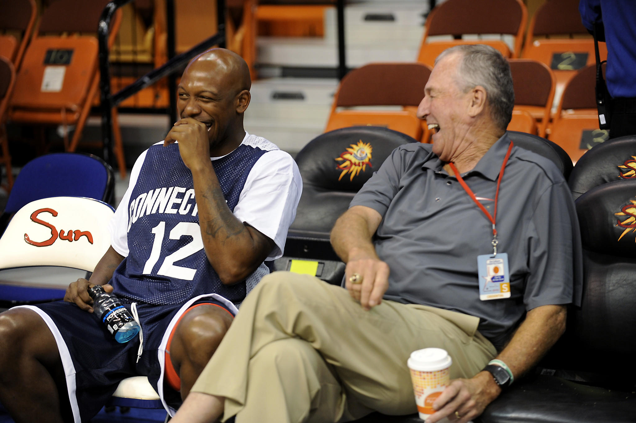 Taliek Brown and Jim Calhoun share a laugh before the start of Calhoun's charity basketball game at the Mohegan Sun Arena Friday.