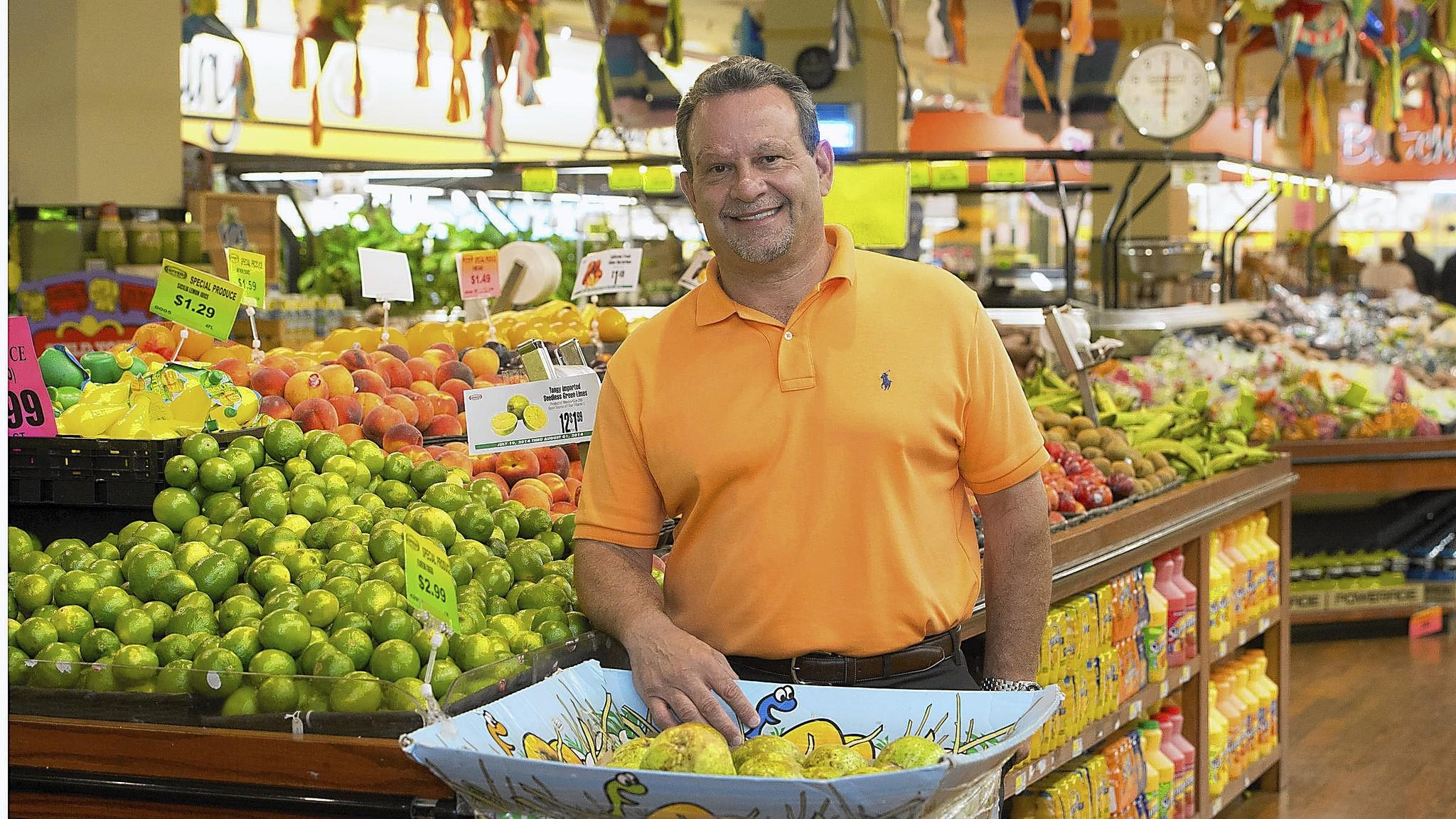 Supremo Food Market owner Eddie Trujillo is in the produce department of his company's Plainfield, N.J. Jersey grocery store. The New Jersey-based grocery chain is opening a store this fall in the long-vacant former Sears building on Allentown's North Seventh Street this fall.