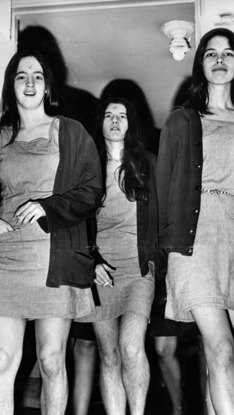"Manson followers Susan Atkins, Patricia Krenwinkel and Leslie Van Houten walk into a morning court session in 1970. When Manson carved an ""X"" into his forehead during the trial, his ""family"" members followed suit."