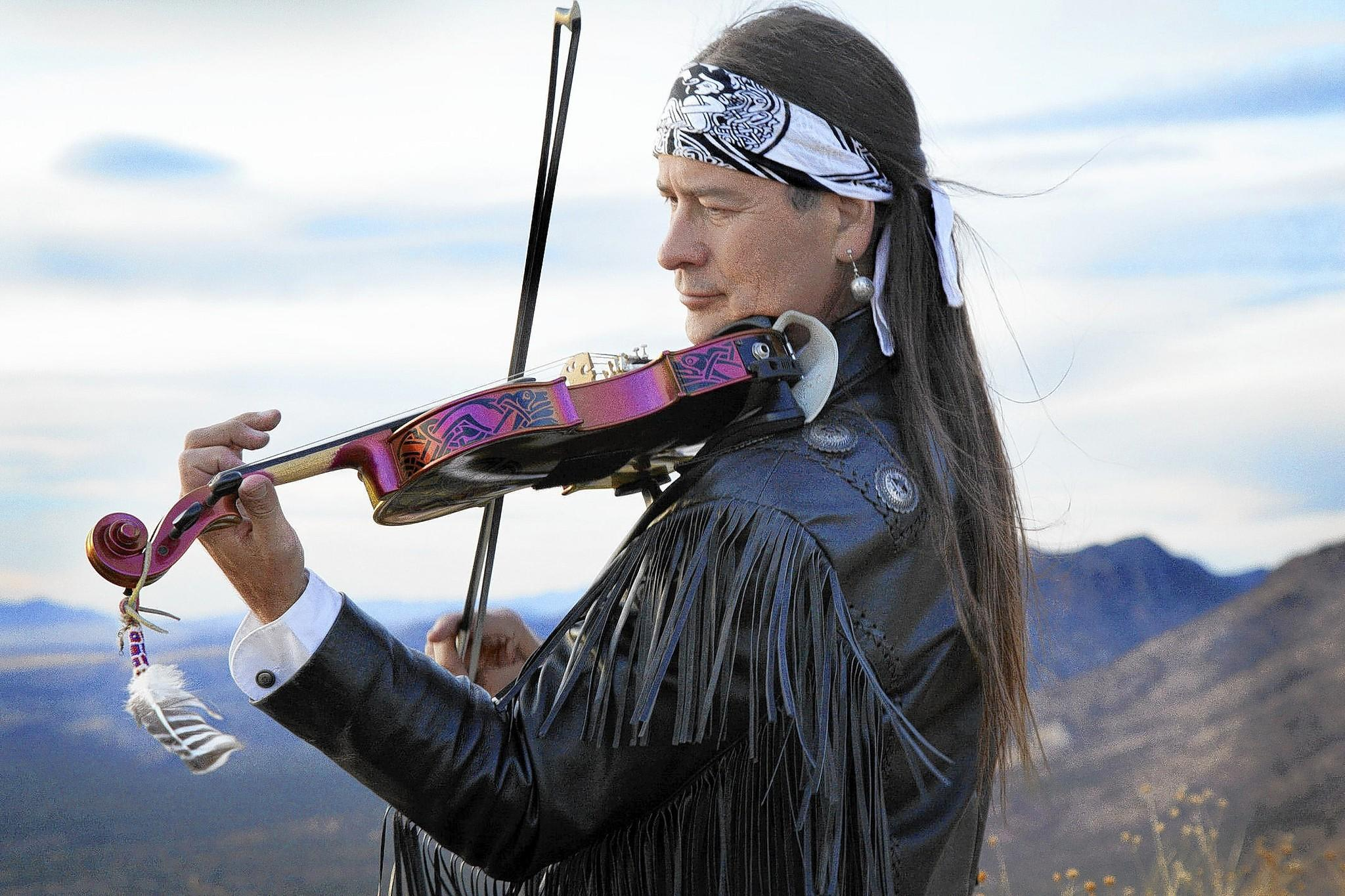Native American (Paiute) violinist and flutist Arvel Bird performs at the 34th Annual Roasting Ears of Corn Festival in Allentown on Aug. 16 and 17.
