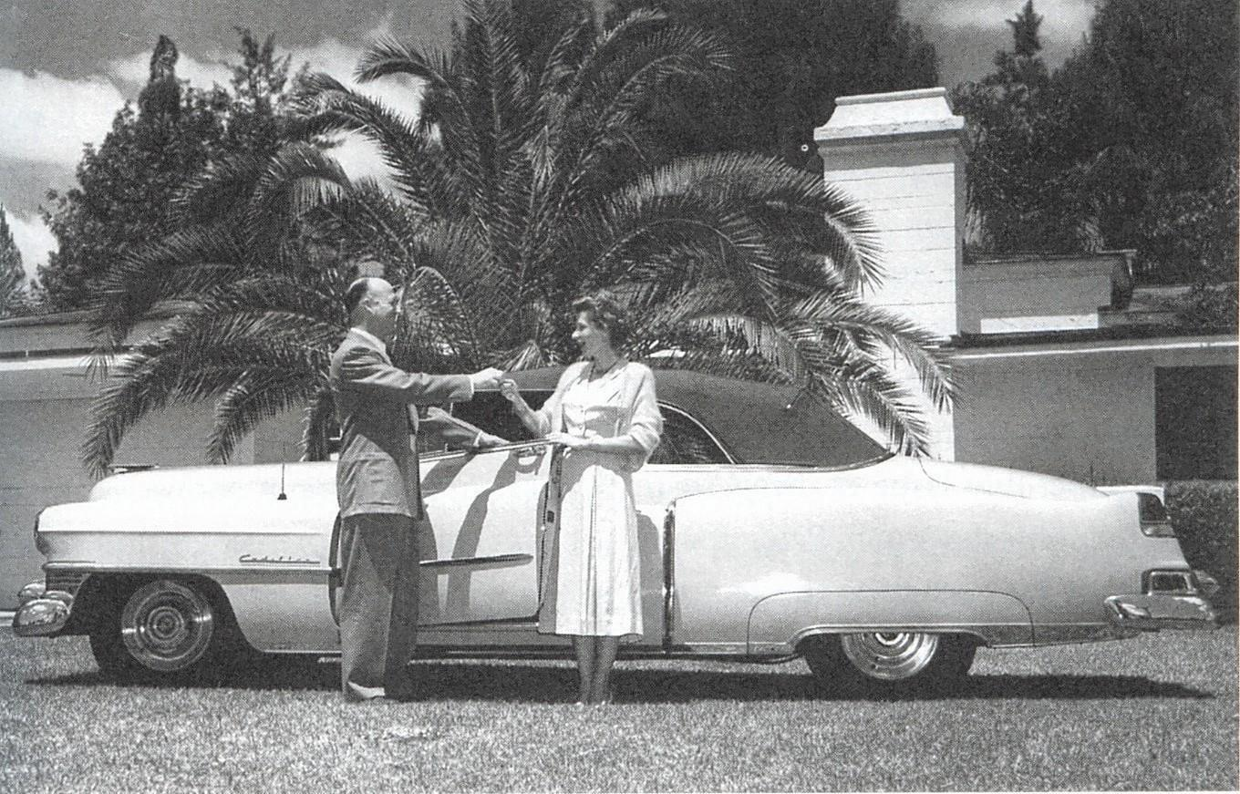 Tupperware founder Earl Tupper rewards Brownie Wise with the keys to a new Cadillac at her Orlando home on Dubsdread Circle in 1952. (She later moved to Kissimmee.)