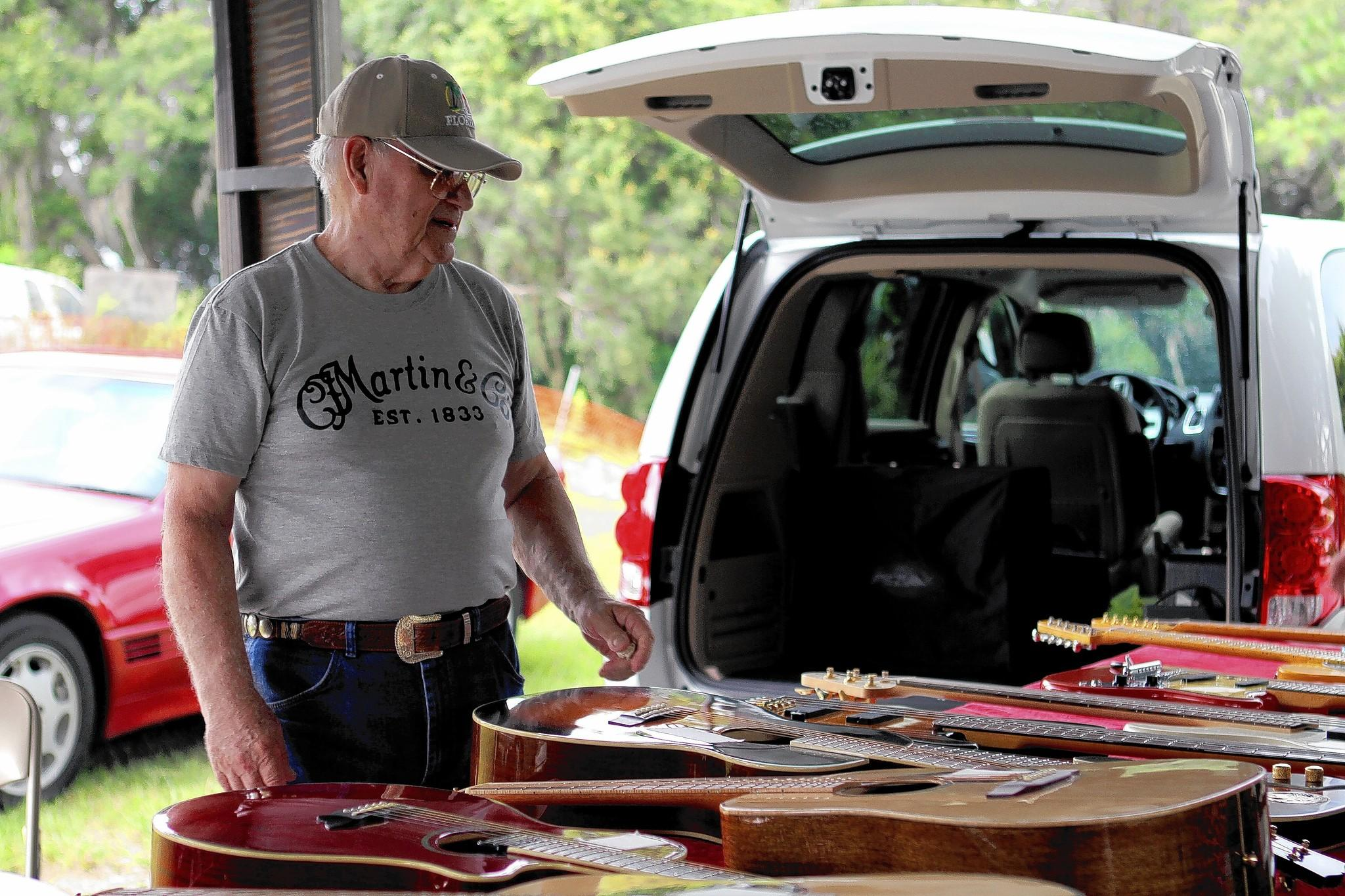 Bob Anness sells his guitars at the monthly swap meet at Renninger's Antique Center in Mount Dora.
