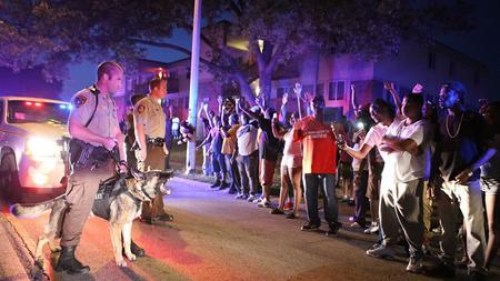 Police: Black teen shot in Missouri was unarmed