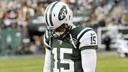 New York Jets quarterback Tim Tebow walks on the sideline during NFL football game against San Diego Chargers in East Rutherford