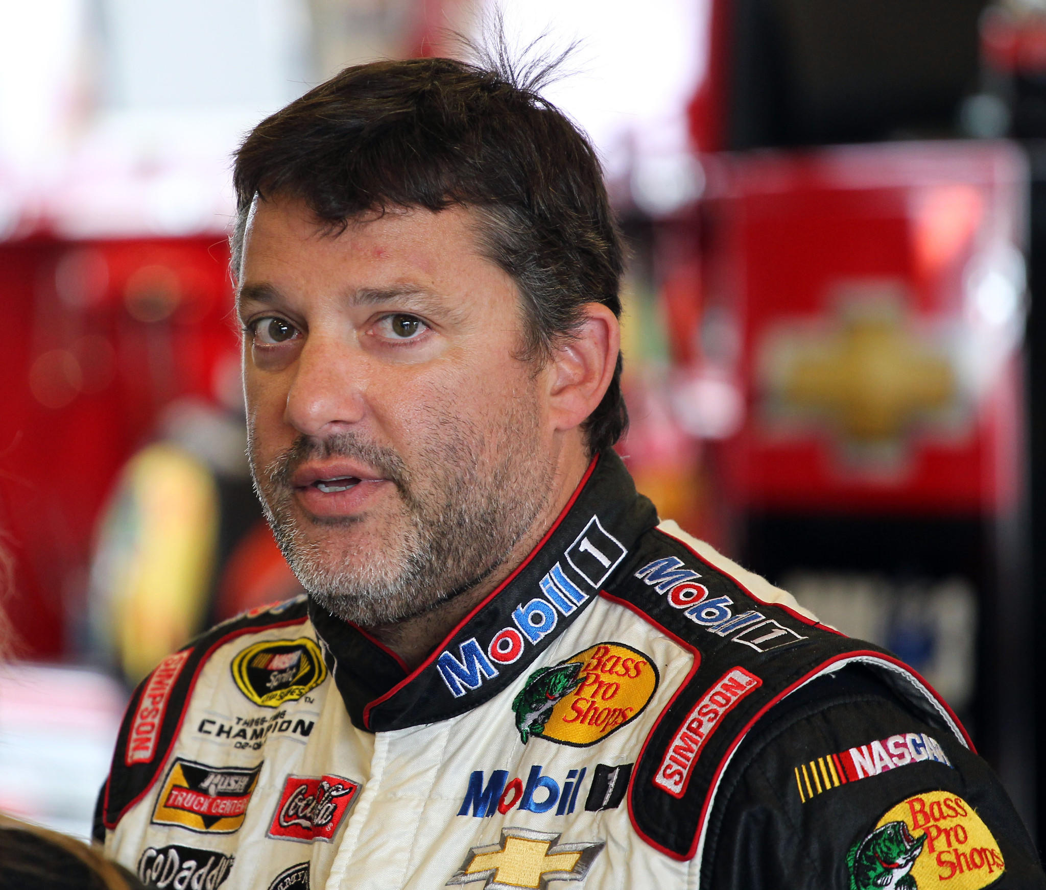 NASCAR Sprint Cup Series driver Tony Stewart stands in his garage during practice for the Crown Royal Brickyard 400 at Indianapolis Motor Speedway in July.
