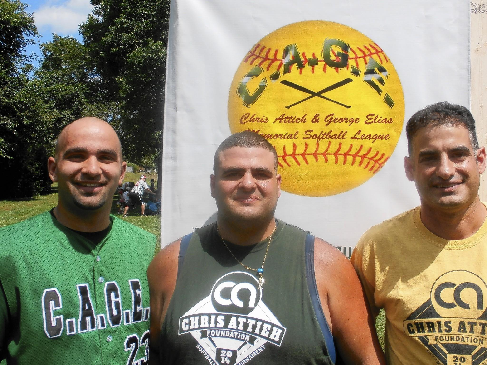 Gus Elias, Joe Attieh and Danny Attieh (from left) are among the organizers of the C.A.G.E. slo-pitch softball league, which honors the memory of their late brothers, George Elias and Chris Attieh.