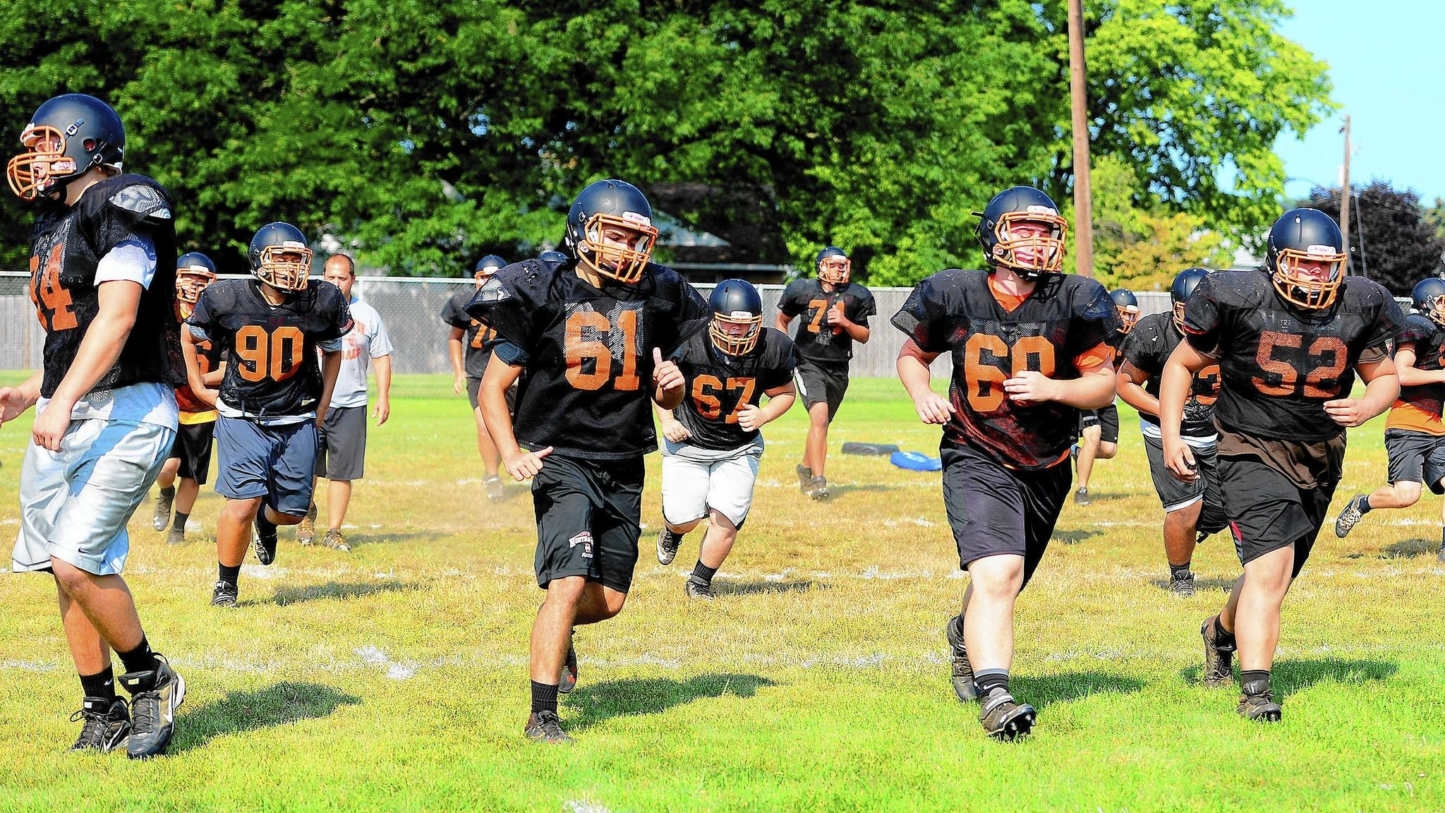 The Northampton football team works out on the first day of fall sports practice.