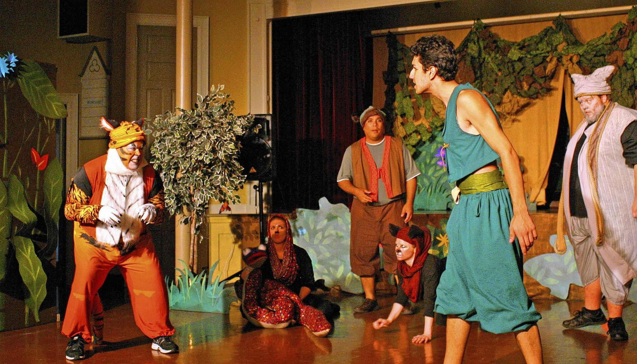 Mowgli the Man-Cub (Teague Fernandez, second from right) confronts Shere Khan the Tiger (Bill Gibson) in front of Mowgli's friends -- (from left), Kaa the Python (Beth Kressin), Bagheera the Panther (Kate Hughes), Baloo the Bear (Justin Ariola) and Great Wolf (Richard Warmkessel).