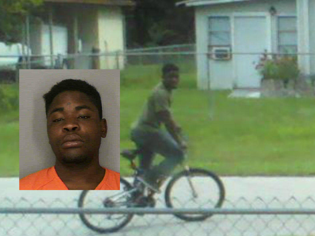 Travis Smith, 22, was charged with robbery and theft. He is the same person seen in this cellphone image riding a bicycle, deputies say.