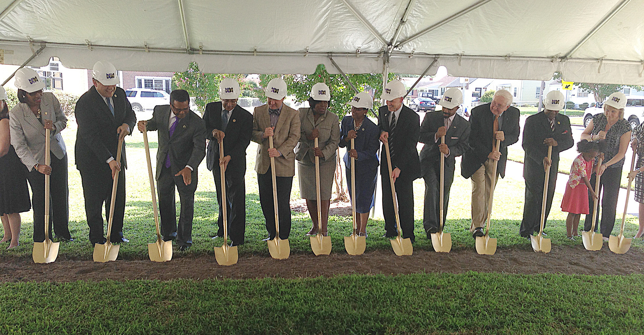 "Community leaders including Newport News Mayor McKinley Price and Rep. Robert C. ""Bobby"" Scott break ground on the new Magruder Discovery STEM academy Tuesday."