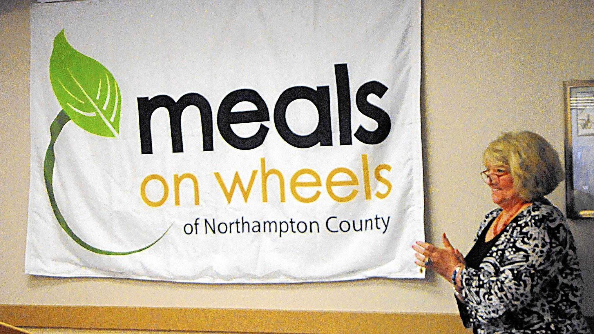 Debra Ghia, vice president of Meals on Wheels of Northampton County, shows off the agency's new logo. Meals on Wheels officials on Tuesday also announced new services as they laid out their three-yearstrategic plan.