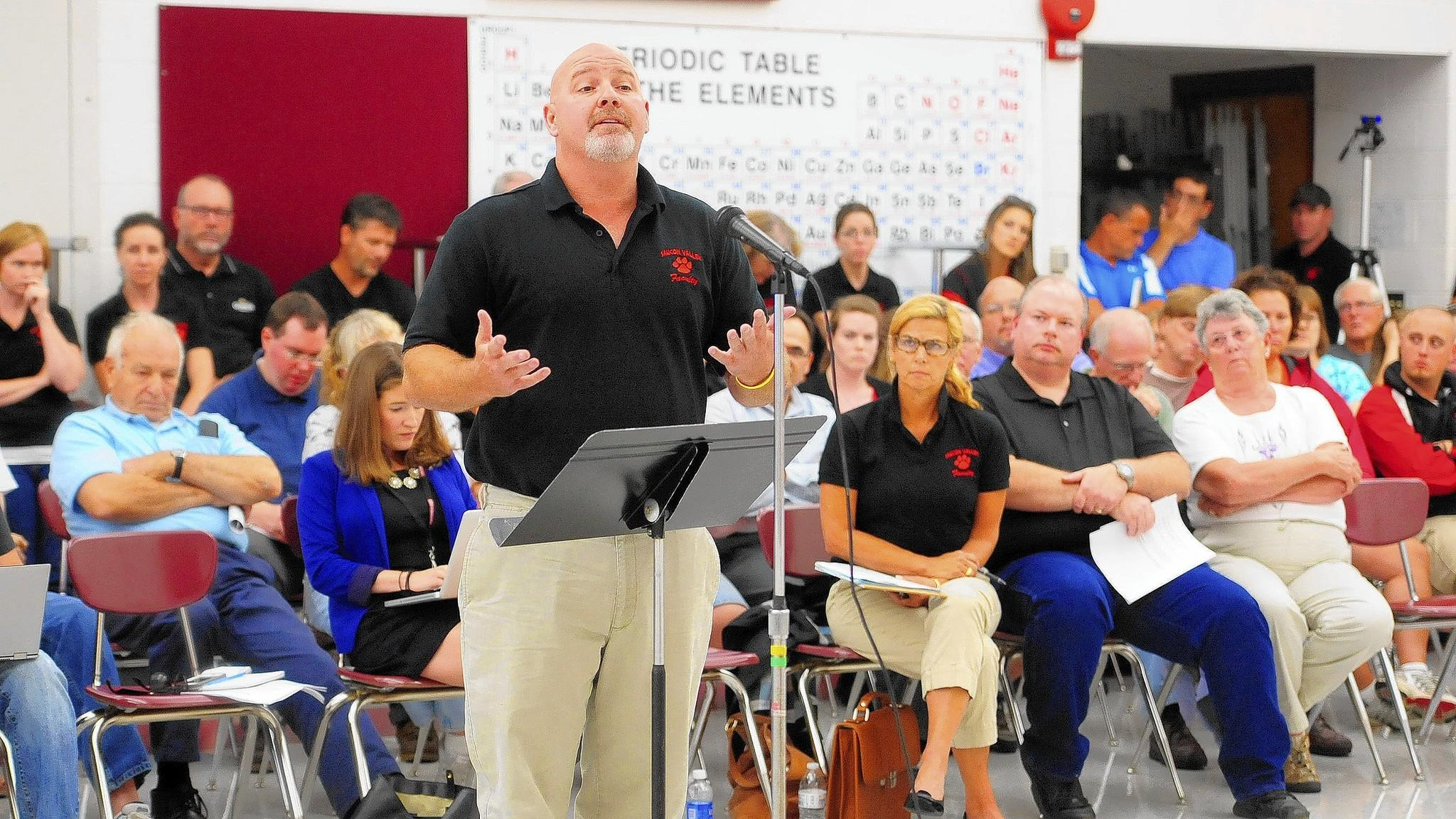 Saucon Valley teachers chief negotiator Rich Simononis addresses the school board Tuesday night. Teachers at the meeting asked one last time to have their contract proposal approved, and were turned down.