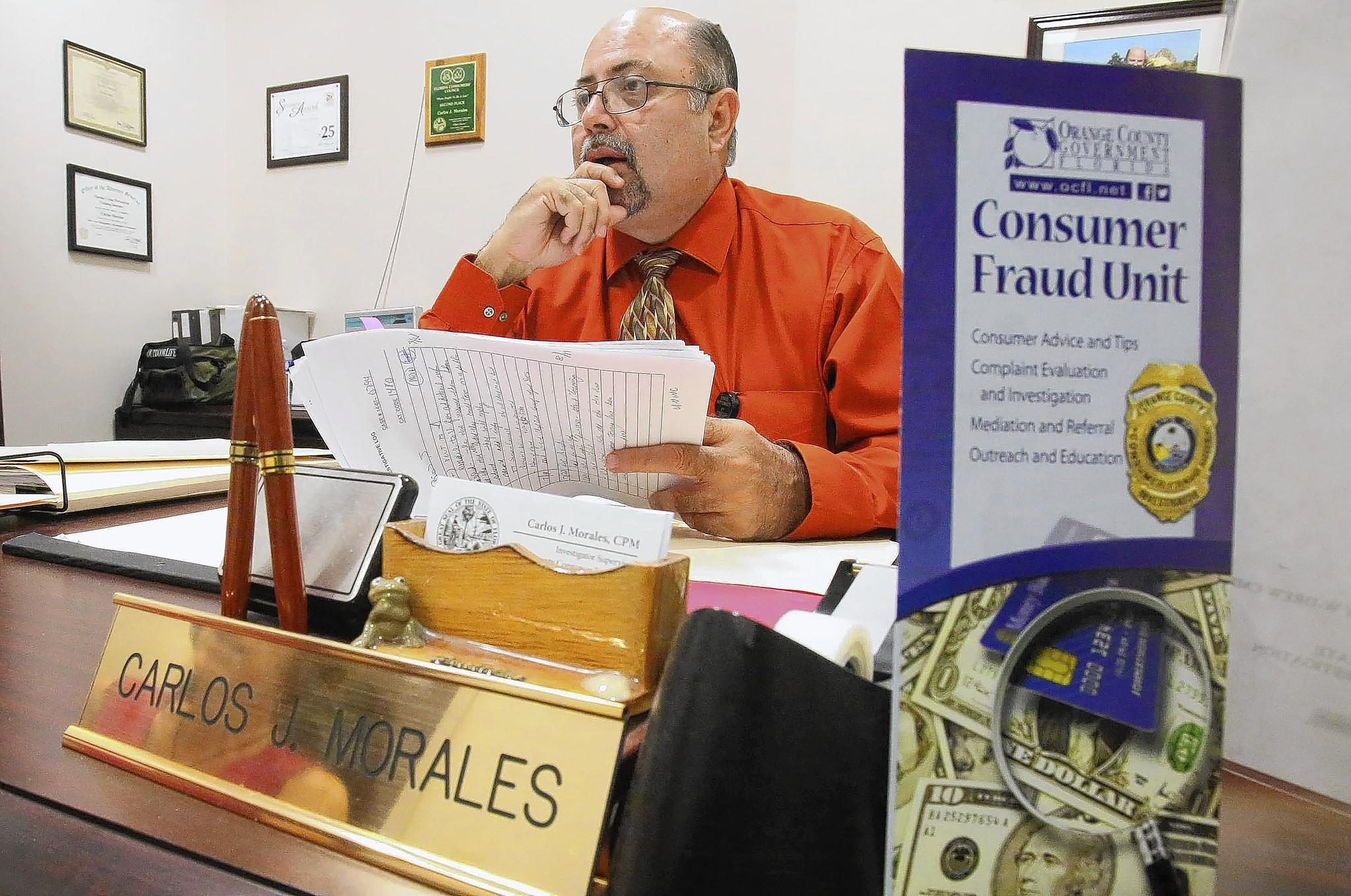 Carlos J. Morales, a supervisor in the Orange County Consumer Fraud Unit, looks through some recent fraud cases.