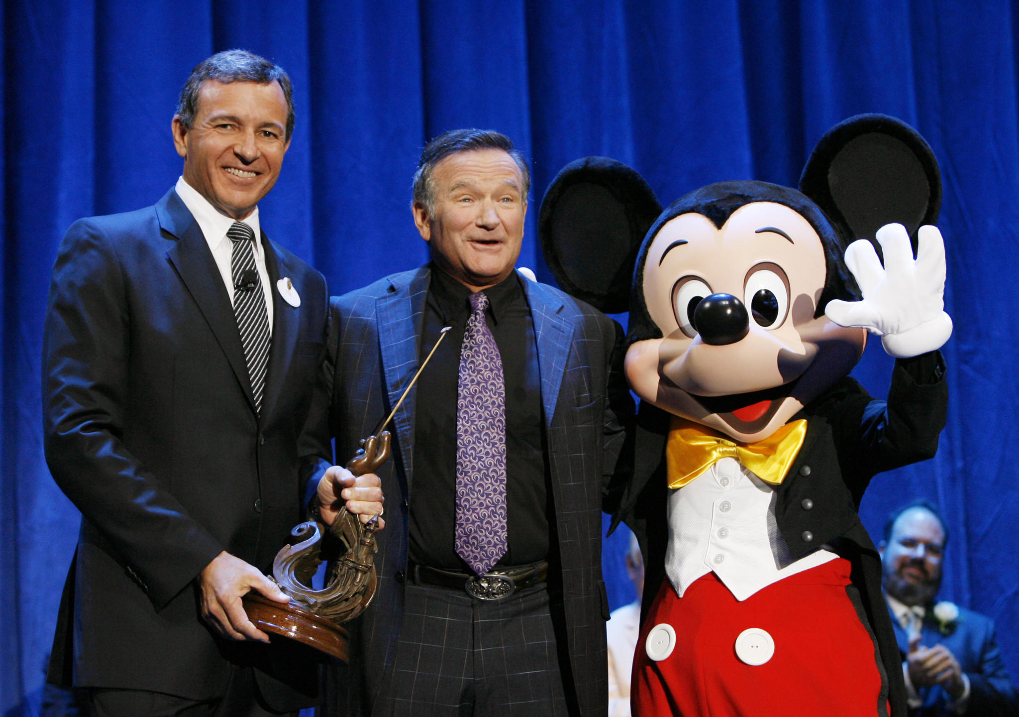 "Robin Williams (center),shown with Disney CEO Bob Iger and Mickey Mouse, was honored in 2009 for his work with the company on films such as ""Aladdin,"" ""Good Morning, Vietnam"" and ""Dead Poets Society."""
