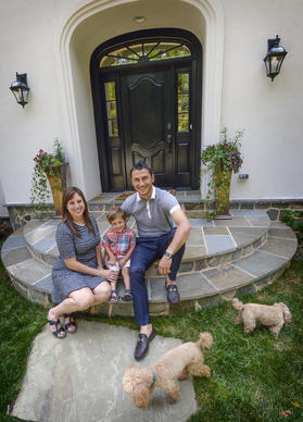 Jessica and Martin Iliev with their three-year-old son, Max in front of their Dream Home.