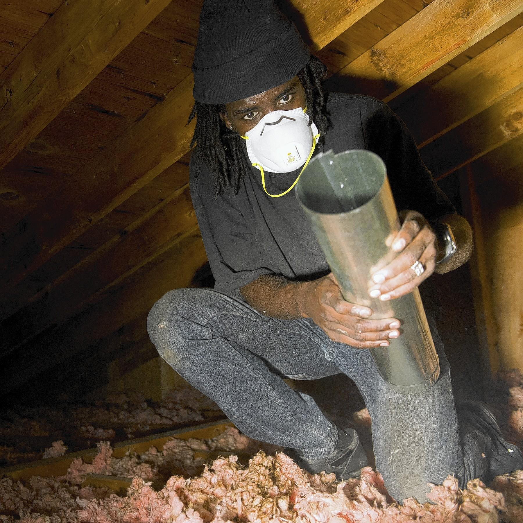 David King of Whitehall works in the attic of a home on Hastings Road in Bethlehem on Wednesday as part of a weatherization blitz of 20 townshouses organized by The Community Action Committee of the Lehigh Valley, PPL Electric Utilities and the network of partners.