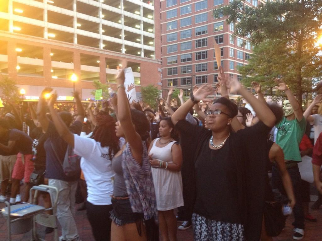 "Those at the rally shout ""Whose streets? Our streets!"" at Power Plant Live. About 300 people attended the rally in Baltimore Thursday evening."