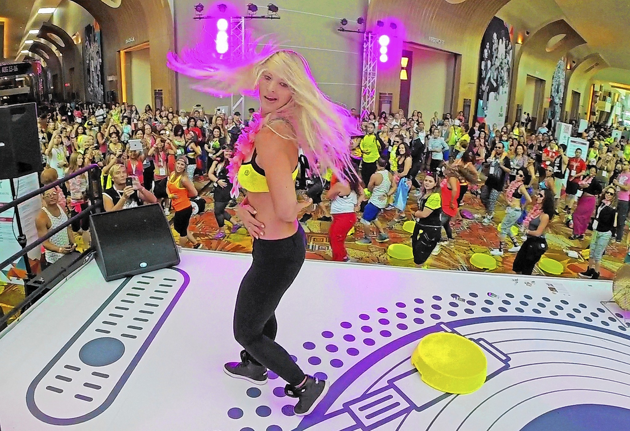 Marcie Benavides of Miami, a Zumba education specialist, demonstrates a new step routine to Zumba instructors at the Hyatt Regency on International Drive.