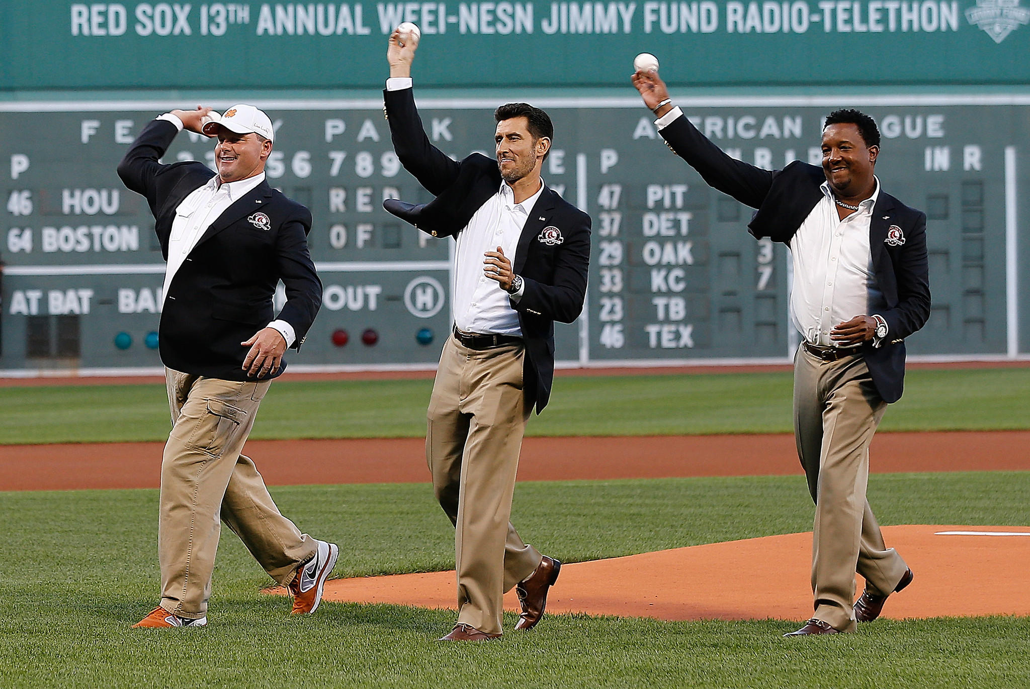 From left, Roger Clemens, Nomar Garciaparra and Pedro Martinez throw out ceremonial pitches after being inducted into the Boston Red Sox Hall of Fame before a game between the Red Sox and the Houston Astros at Fenway Park on Thursday night.