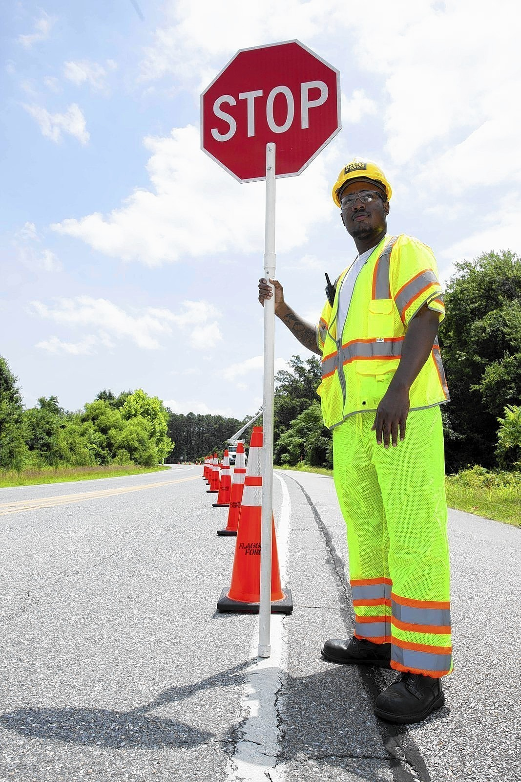 Construction Traffic Control : Flagger force construction zone safety company expands in
