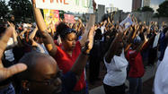 City protesters march to decry police actions in St. Louis and at home