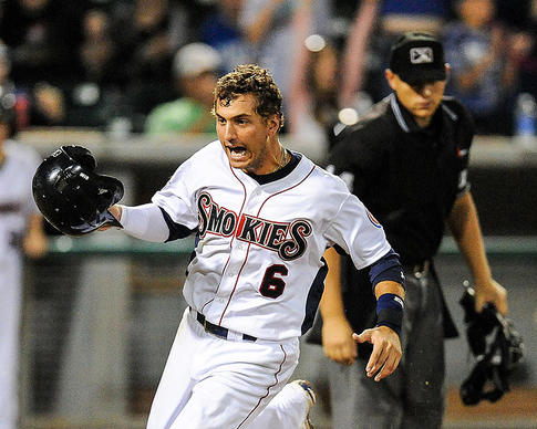 Albert Almora celebrates as he crosses home plate for the winning run in the Tennessee Smokies' 1-0 home victory over the Huntsville Star