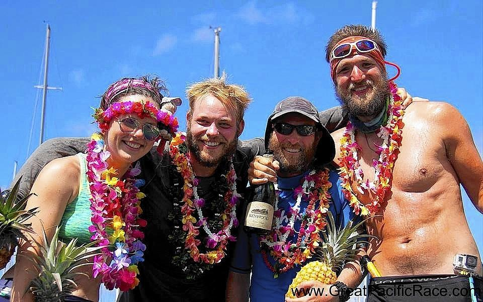 The Pacific Warriors celebrate after crossing the finish line of their 57-day journey rowing across the ocean. From left: Susannah Cass