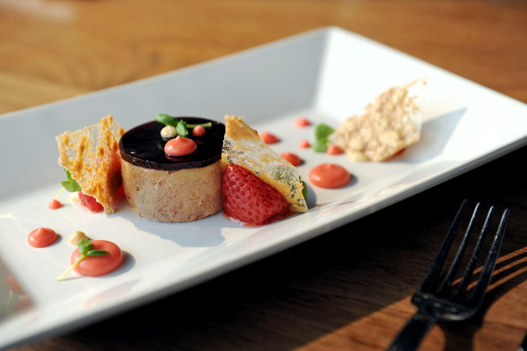 The Hudson Valley foie gras torchon includes peanut butter crisps, cassis gelee and pickled strawberries.
