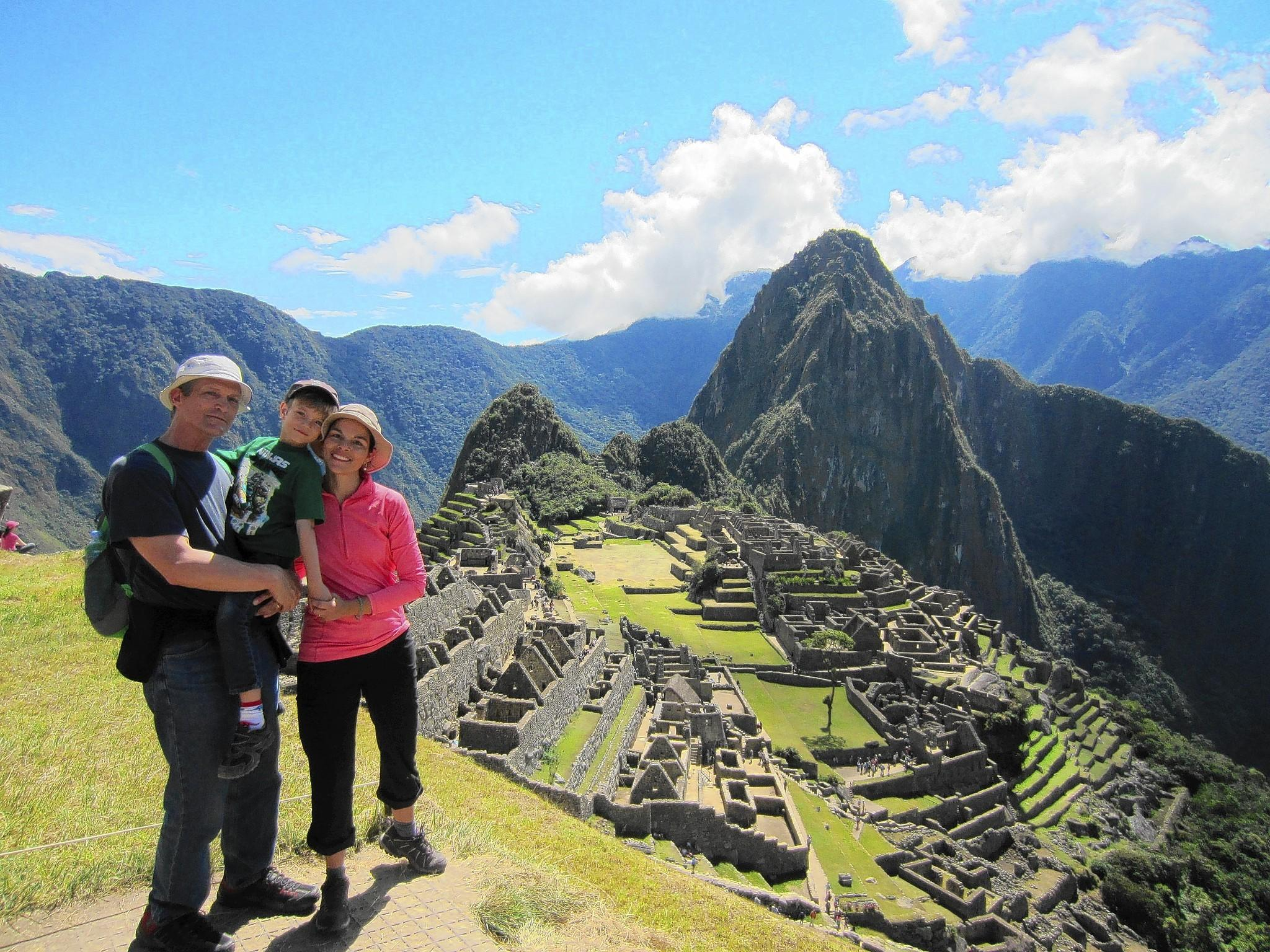 Daily Press staff writer Mark St. John Erickson, his son, Owen, and wife, Miriam Stawowy, stop for a family picture on a scenic overlook high above the world-famous mountain-top ruins of Peru's Machu Picchu.