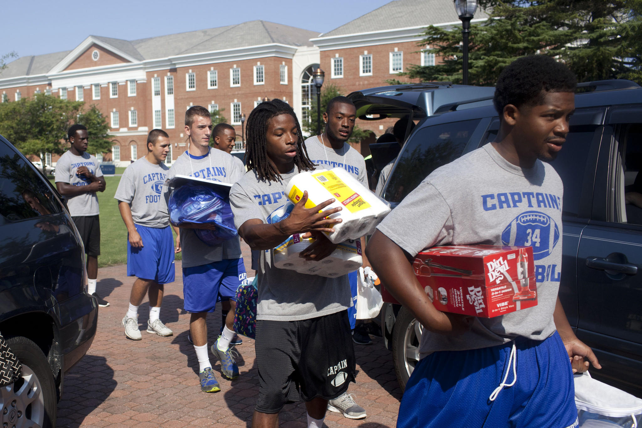 Student athletes help freshmen move in to the dorms at Christopher Newport University on August 16, 2014.