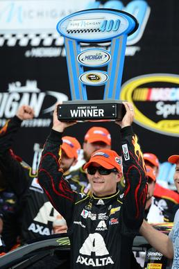 Aug 17, 2014; Brooklyn, MI, USA; NASCAR Sprint Cup Series driver Jeff Gordon celebrates in victory lane after winning the Pure Michigan 400 at Michigan International Speedway.