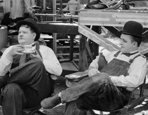 "1932: Stan Laurel, with a blackened eye, and Oliver Hardy during a break in the filming of ""Towed in a Hole,"" directed by George Marshall. [For the record: This caption previously stated that the film was 1928's ""The Finis"
