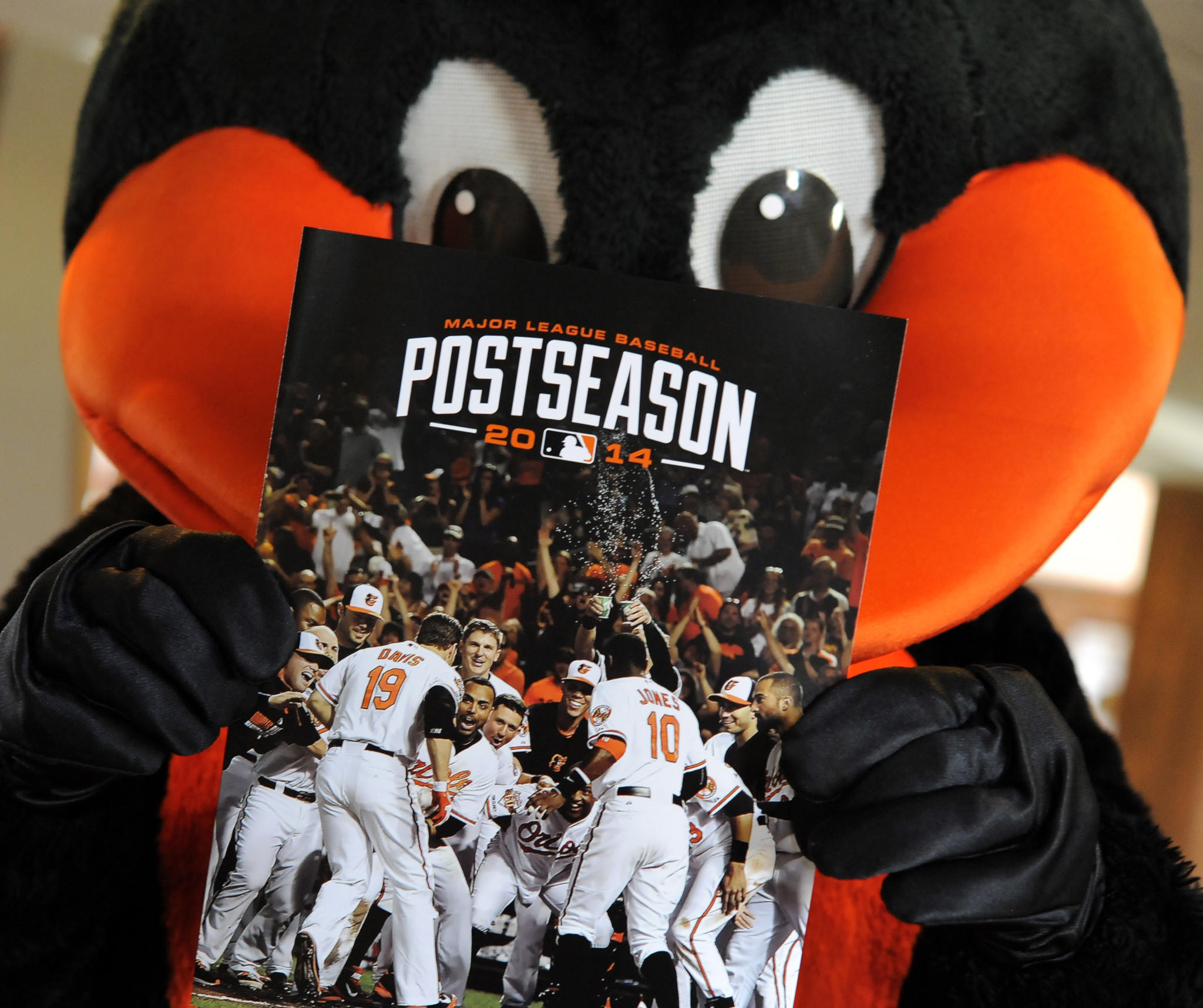 The Oriole Bird holds a packet for 2014 playoff tickets. The Orioles are sending playoff ticket invoices to season-ticket holders for a third straight season.