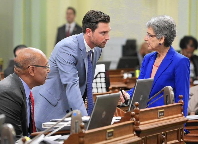 Assemblyman Chris Holden, left, says more work is needed on energy legislation. (Rich Pedroncelli / Associated Press)